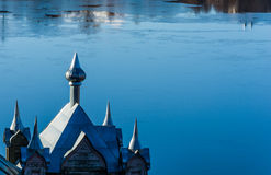 Church domes on the blue background of the river. Royalty Free Stock Photo