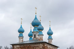 Church domes on a blue sky background. Royalty Free Stock Photos