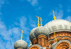 Church domes on a blue sky background. Royalty Free Stock Image