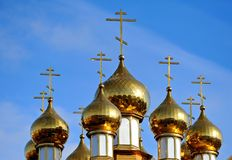 Church domes with crosses on a background of blue sky. Russia, Belgorod Royalty Free Stock Image
