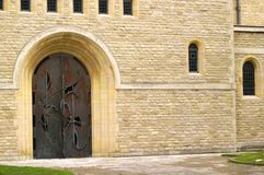 Church Door. Decorative Arched Door in a Stone Building Stock Images