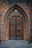 Church Door. An arched doorway to a gothic style church Royalty Free Stock Images
