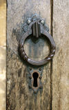 Church door. Old wooden church door with iron cast lock and handle stock photography