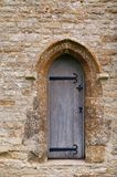 Church door from Cotswolds. Small church door from Norman period chapel in the Cotswolds England Royalty Free Stock Photo