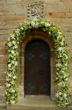 Church Door. An external view of the intricate wooden door at Chrichton collegiate church Royalty Free Stock Image
