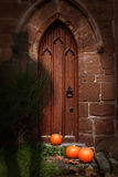 Church Door At Halloween. With ghost wearing top hat Royalty Free Stock Photos