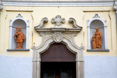 church door in italy lombardy shield statue royalty free stock image