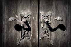 Church door rusty metallic handle. Ancient handle of the church wooden door covered with rust Stock Images