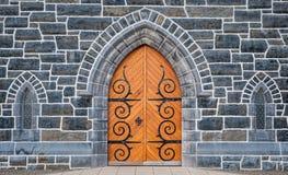 Church door and stone wall windows Stock Photo