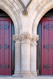 Church doors. Red wooden church doors with arches Royalty Free Stock Images