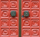 Church doors. Close up of a grid pattern on a red door with door handles Stock Photography