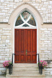 Church doors. Gothic oak wooden church doors with ornate metal hardware Stock Photo