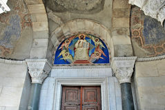 Church Doors and icon above her Stock Photography