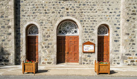 Church doors. Old wooden Church doors with flowers boxes Royalty Free Stock Photo