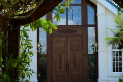 Church Doors. Partially framed with the arbor located at the enrty Royalty Free Stock Photo