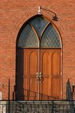 Church doorway. Arched church doorway taken in the early morning Stock Images