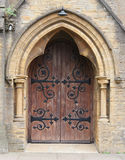 Church doorway. Gothic church doorway with wooden doors and intricate metal hinges royalty free stock photography