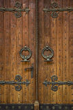 Church doorway with wooden doors Stock Photos