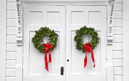 Church Double Door Christmas Wreaths. The double door entrance to this church has Christmas Wreaths stock image