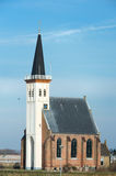 Church at the Dutch island Texel. White little church in small village Den Hoorn at Dutch island Texel stock photo