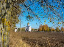 Church on the edge of plowed field. Stock Images