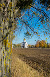 Church on the edge of plowed field. Stock Photo