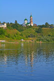 Church of Elijah the Prophet on the abrupt bank of Oka river in Kasimov city, Russia. View of the coast of Oka river from motorship in Kasimov, Ryazan region stock images
