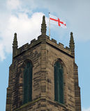 Church of England. Tower flying cross of St George flag royalty free stock photography