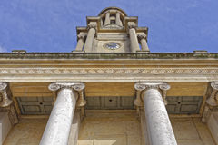 Church, england. Image showing the magnificent architecture and ionic pillars of holy trinity or commenwealth church with a blue sky background, great portland Royalty Free Stock Photography