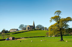 Church in the English countryside. Scenic view of Barsdea church in green countryside, Cumbria, England Royalty Free Stock Images