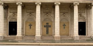 Church entrance. Entrance to an old church building, marble columns and decorative crosses adorn the stairs and wall Royalty Free Stock Photo