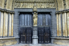 Church entrance. Old Christian church entrance decorated with marble statues Stock Image