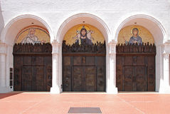 Church Entrance. Triple bronze door church entrance with mosaic murals above each door Royalty Free Stock Photo