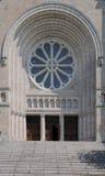 Church entrance. A Romanesque style church entrance welcomes us with an open door Royalty Free Stock Photos