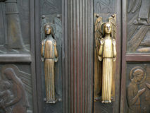 Church Entrance Door. Decorative church entrance with angels as door handles Royalty Free Stock Photography