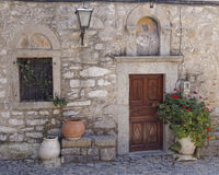 Church entrance and  flowerpots Royalty Free Stock Photography