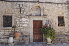 Church entrance and  flowerpots Stock Photos
