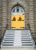 Church entrance with yellow doors Stock Images
