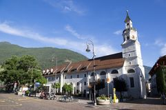 Church, Erhardkirche, Brixen, Bozen, Italy, Europe. Church named Erhardkirche, Brixen, Bozen Bressanone, Italy, Europe, blue sky and mountains royalty free stock image