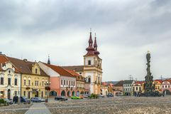Main square in Kadan, Czech republic. Church of the Exaltation of the Holy Cross and Holy Trinity Column on main square of Kadan, Czech republic Royalty Free Stock Photography