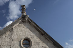 Church facade. With architectural sculpture at saint Lawrence monastery, Åibenik stock photography