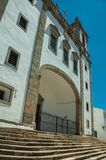 Church facade in baroque style with arched gateway and staircase. Church facade in baroque style, with arched gateway and staircase in a sunny day at Campo Maior royalty free stock images