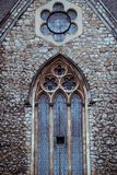 Church facade. Close-up photo of a Gothic church facade Stock Photos