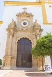 Church facade with yellow trim in Marbella, Andalucia Spain Stock Photos