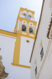 Church facade with yellow trim in Marbella, Andalucia Spain. Castle with battlements and walls of red stones, Villafames rural villa in Castellon, Valencia Royalty Free Stock Photo