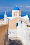 Church with famous blue dome on Santorini island, Greece. Aegean sea view Stock Images