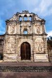 Church fassade ruin of Ermita de Santa Isabel with dramatic cloudscape vertical, Antigua, Guatemala royalty free stock images