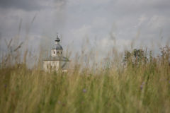 A church in a field. An old Christian Chirch in Suzdal, Russia Royalty Free Stock Photography