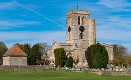 Church on a fine Spring day. Thame church on a fine Spring day with churchyard and outbuilding stock photography
