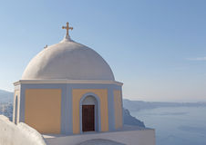 Church in Fira against caldera Stock Photography